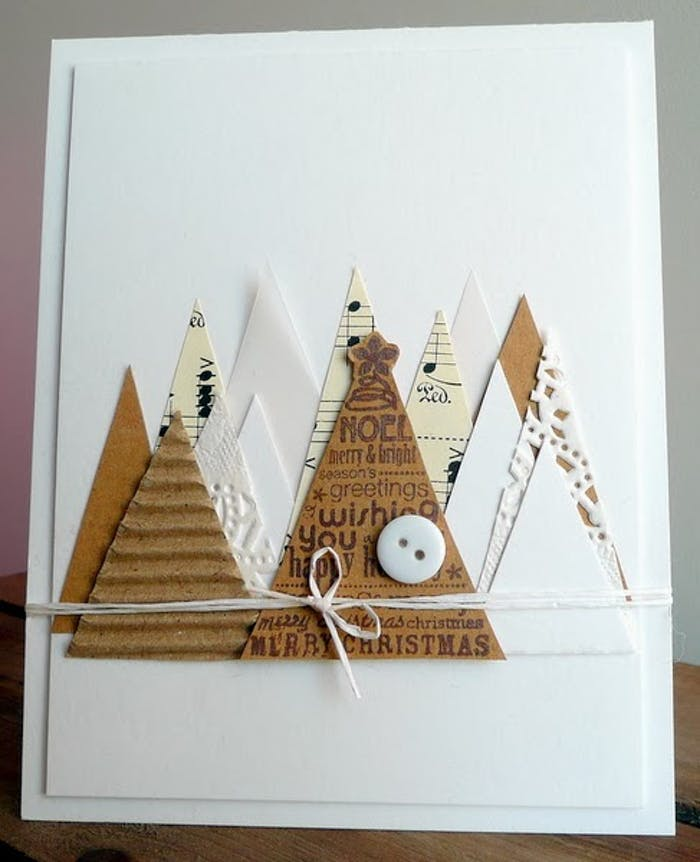 "White Christmas card decorated with triangular cut-outs representing Christmas trees.<span class=""sr-only""> (opened in a new window/tab)</span>"