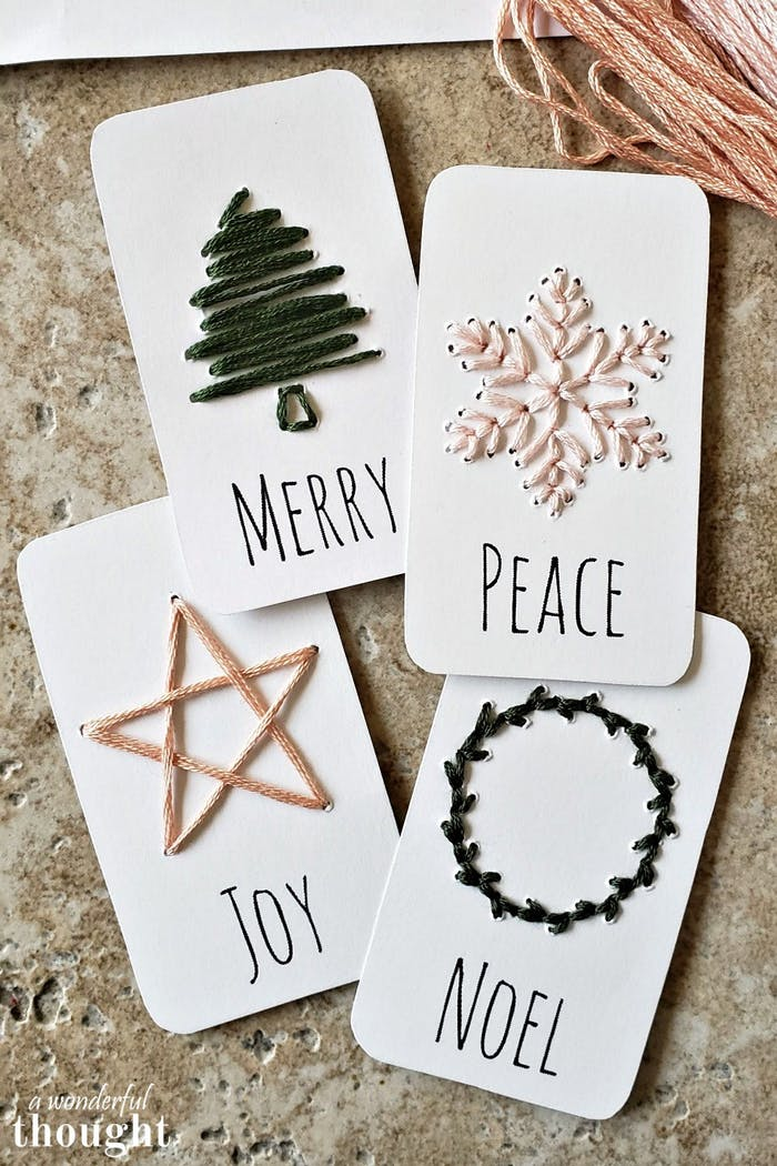 """Hand embroidered gift tags.<span class=""""sr-only""""> (opened in a new window/tab)</span>"""