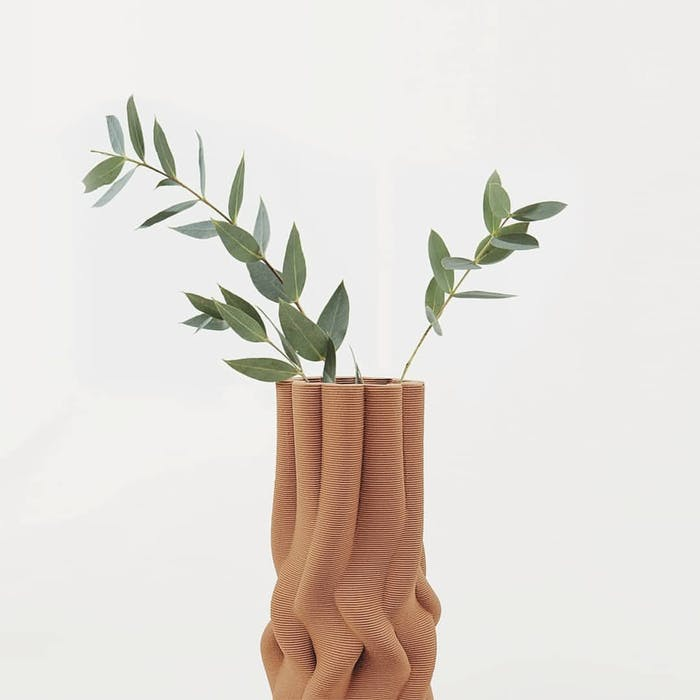 "Clay vase containing greenery.<span class=""sr-only""> (opened in a new window/tab)</span>"