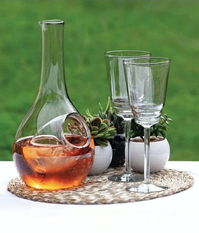 "Recycled glass decanter and glasses styled on a table.<span class=""sr-only""> (opened in a new window/tab)</span>"