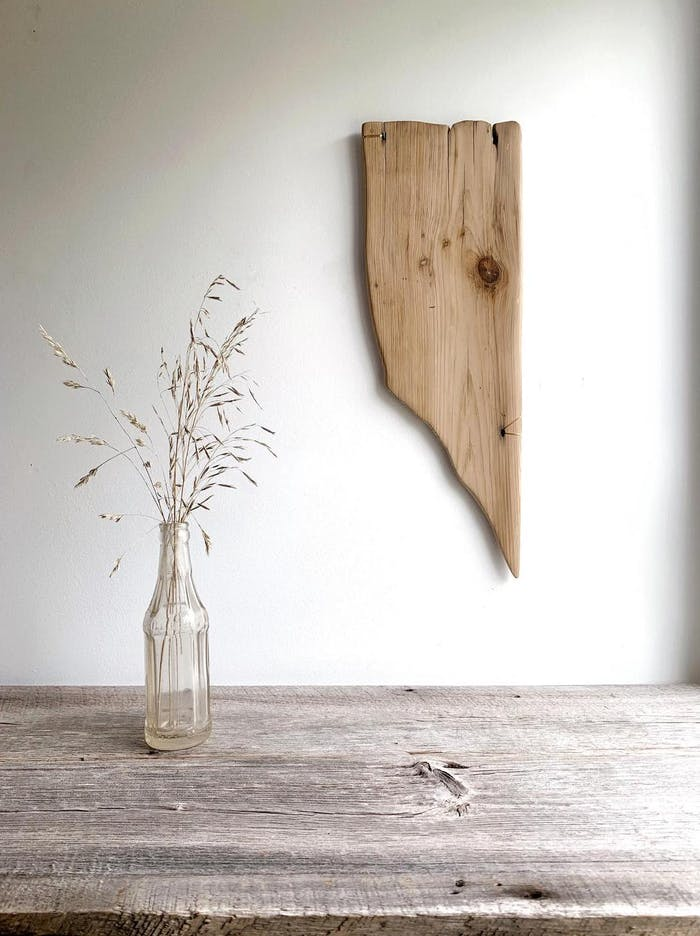 "Driftwood artwork hung on a wall.<span class=""sr-only""> (opened in a new window/tab)</span>"