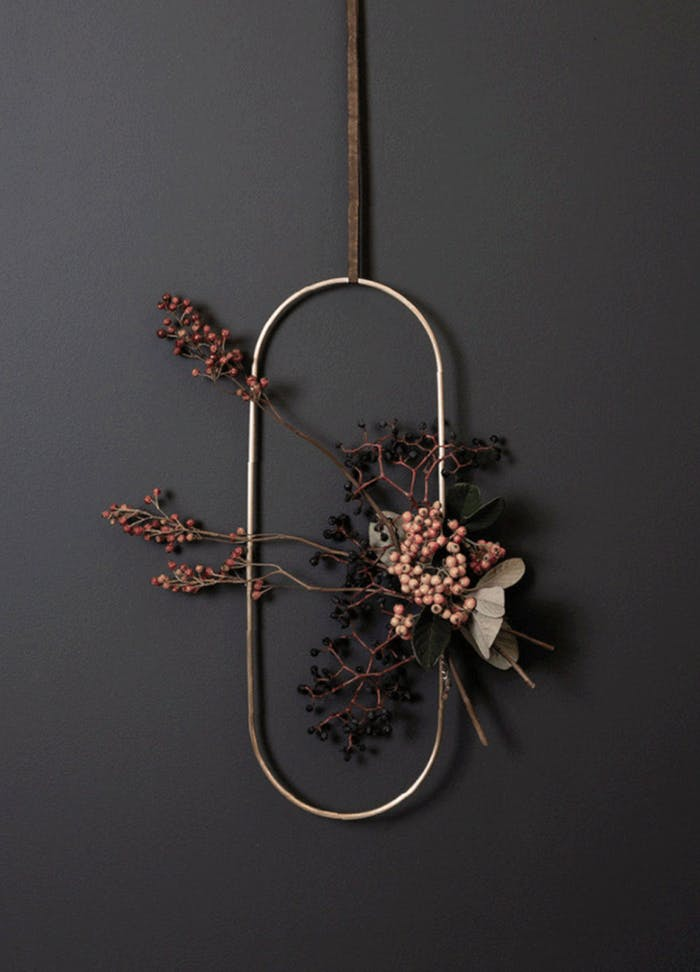 """Oval metal wreath decorated with berry branches.<span class=""""sr-only""""> (opened in a new window/tab)</span>"""
