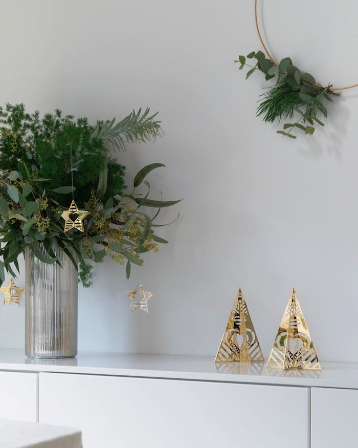 """Festive vignette created with real greenery and golden metal ornaments.<span class=""""sr-only""""> (opened in a new window/tab)</span>"""