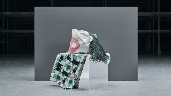 """A tote bag and a tablecloth from IKEA's MUSSELBLOMMA collection.<span class=""""sr-only""""> (opened in a new window/tab)</span>"""
