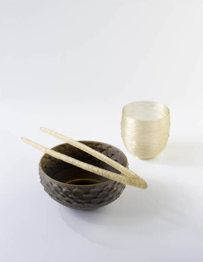 """3D printed bowl, glass and chopsticks made with an algae-based polymer.<span class=""""sr-only""""> (opened in a new window/tab)</span>"""