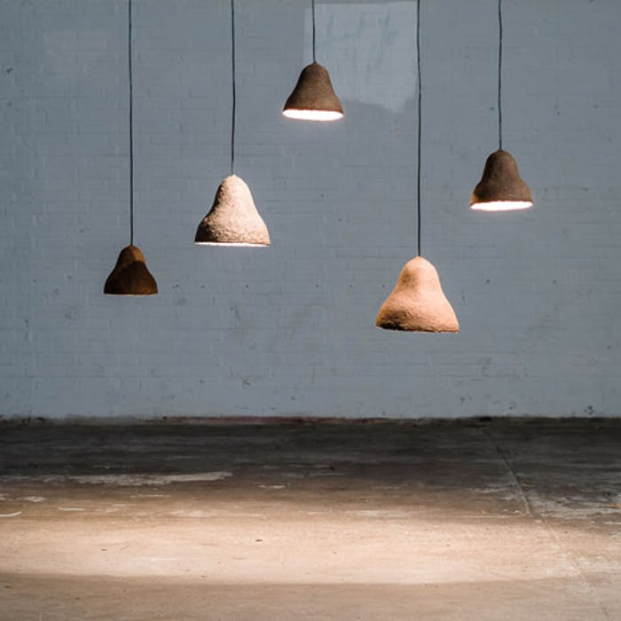 """An arrangement of pendant lamps made of seaweeds & paper styled in a room.<span class=""""sr-only""""> (opened in a new window/tab)</span>"""