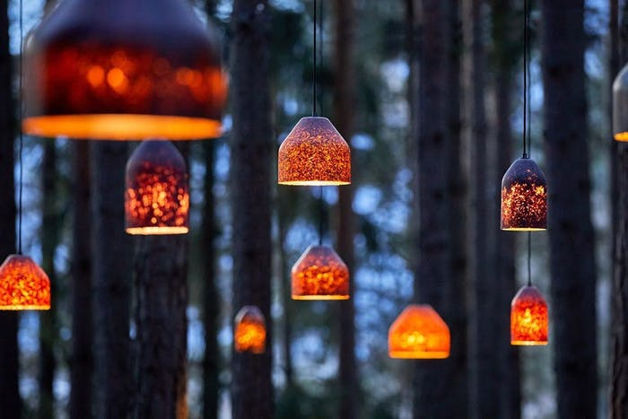 "Pendant lamp made of fallen leaves displayed in a forest.<span class=""sr-only""> (opened in a new window/tab)</span>"