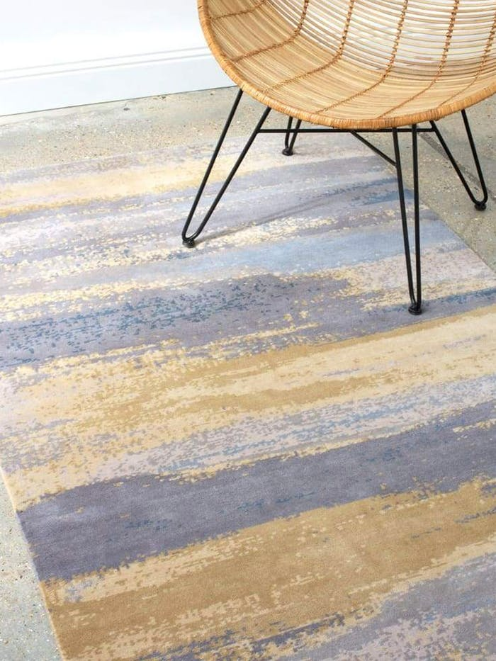 """Recycled plastic rugs under a marble coffee table.<span class=""""sr-only""""> (opened in a new window/tab)</span>"""