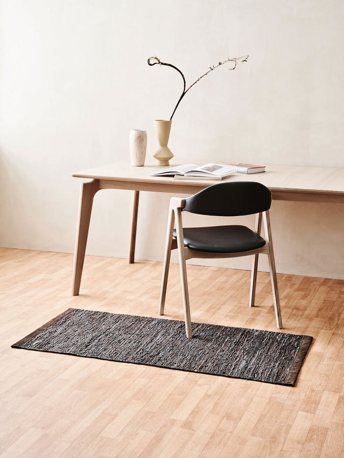 """Recycled PET rugs styled in a rustic showroom.<span class=""""sr-only""""> (opened in a new window/tab)</span>"""