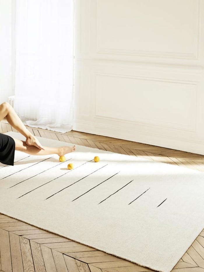 """Entryway with a long and skinny sisal&jute rug.<span class=""""sr-only""""> (opened in a new window/tab)</span>"""
