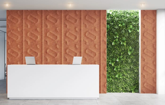 "Welcome hall of an office space with back wall finished with a surface made of organic waste in a rusty colour.<span class=""sr-only""> (opened in a new window/tab)</span>"