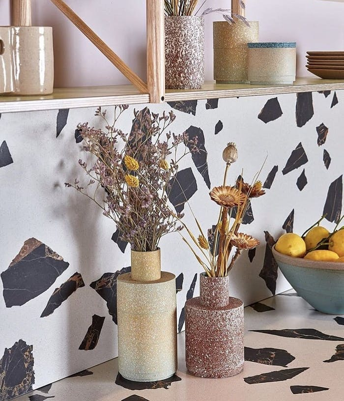 """Close-up of a worktop with flowers and food on top of it.<span class=""""sr-only""""> (opened in a new window/tab)</span>"""