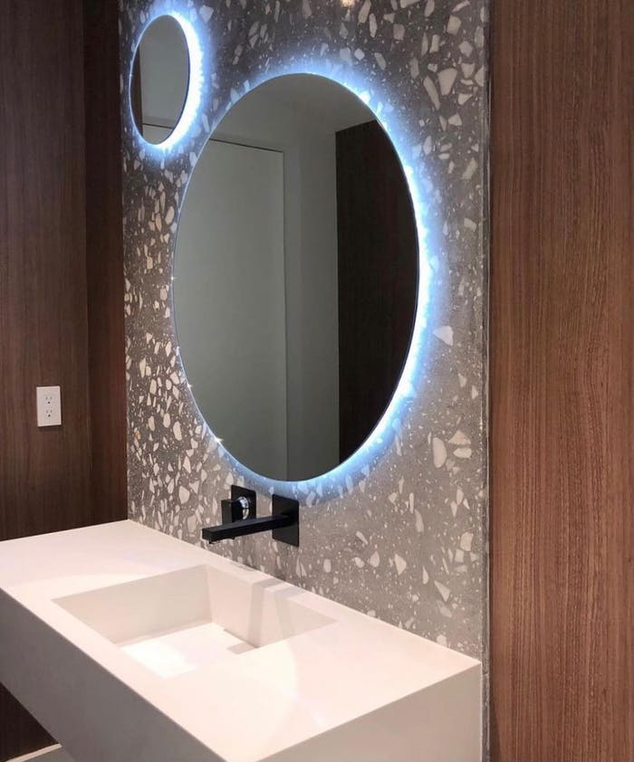 "Contemporary bathroom with back wall finished with recycled stone surface.<span class=""sr-only""> (opened in a new window/tab)</span>"