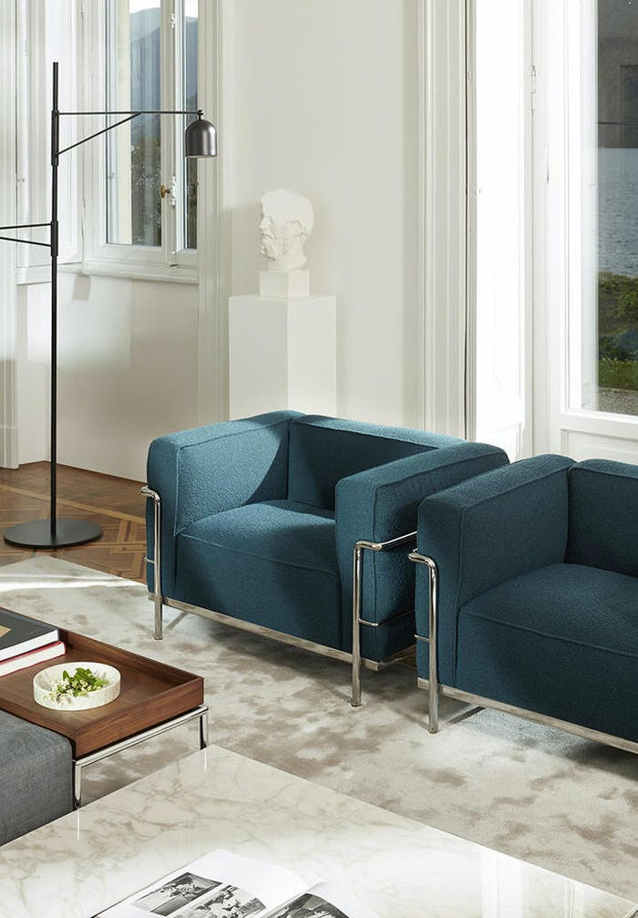 "Peacock blue armchair in a modern living room.<span class=""sr-only""> (opened in a new window/tab)</span>"