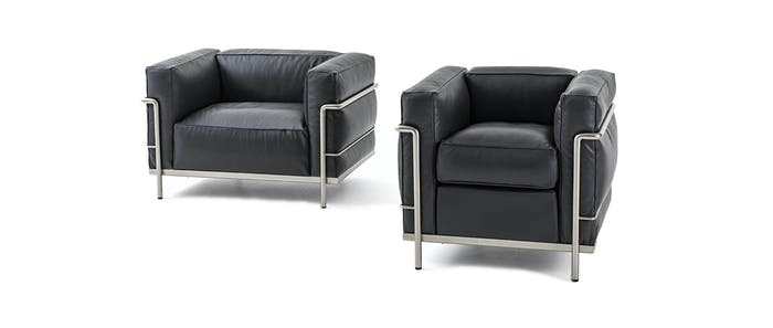 "Black leather armchair edited with sustainable design in mind.<span class=""sr-only""> (opened in a new window/tab)</span>"