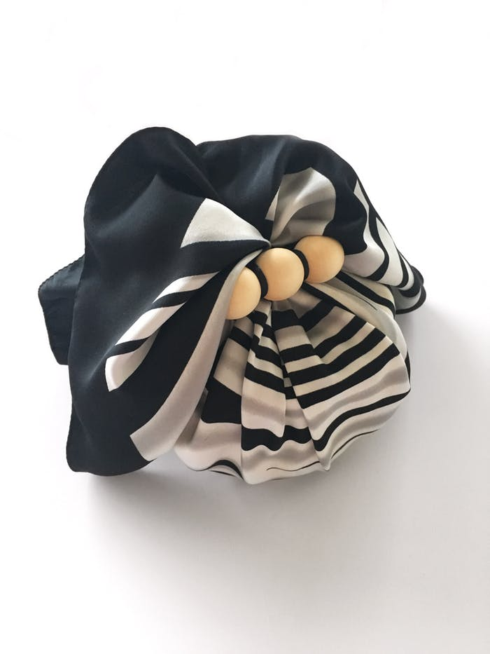 "Gift wrapped into a scarf as an example of sustainable gift wrapping.<span class=""sr-only""> (opened in a new window/tab)</span>"