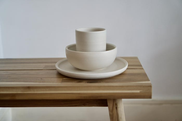 """Plates and cups on a table.<span class=""""sr-only""""> (opened in a new window/tab)</span>"""