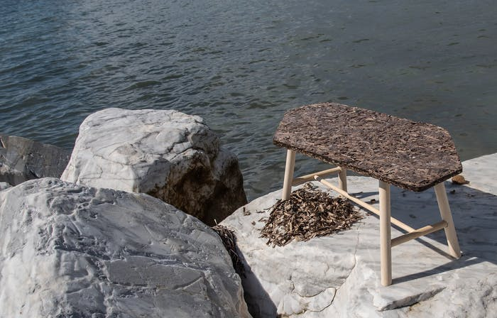 """Low table made of algae and wood, styled on a rock next to the sea.<span class=""""sr-only""""> (opened in a new window/tab)</span>"""