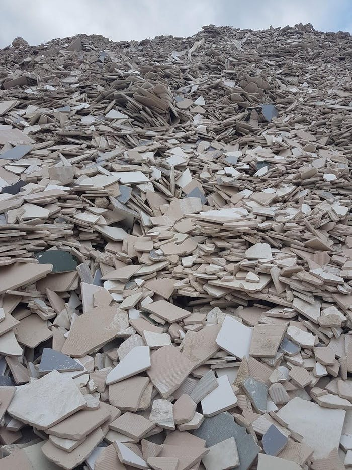 """A huge pile of ceramic waste in a landfill.<span class=""""sr-only""""> (opened in a new window/tab)</span>"""