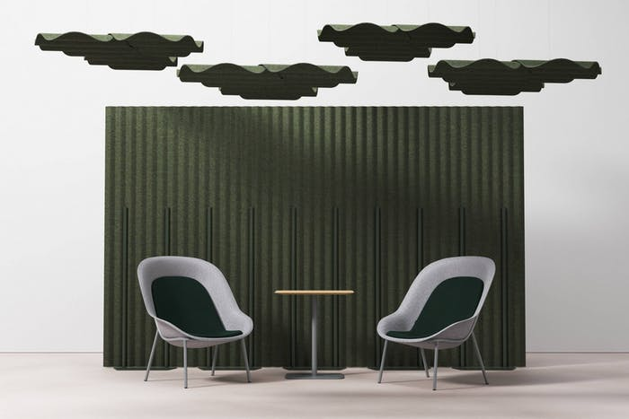"Seating area created in front of an acoustic room dividor and more acoustic panels hanging from the ceiling.<span class=""sr-only""> (opened in a new window/tab)</span>"