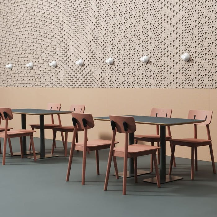 "Restaurant design in a pink palette with a textural acoustic panel decorating the wall.<span class=""sr-only""> (opened in a new window/tab)</span>"
