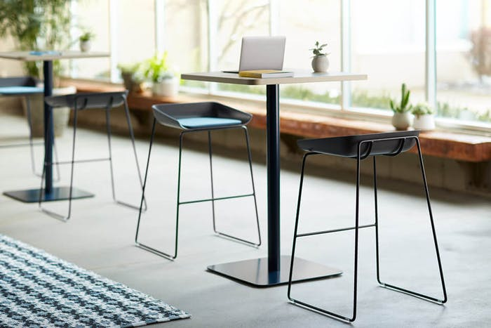 """Tall tables with Cradle to Cradle Certified™ stools.<span class=""""sr-only""""> (opened in a new window/tab)</span>"""