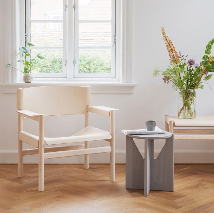 """FSC® certfied chair styled with side table and flowers.<span class=""""sr-only""""> (opened in a new window/tab)</span>"""