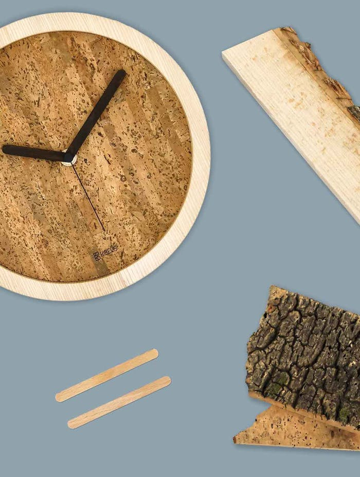"""Wall clock styled next to its components: popsicle sticks, wood and cork.<span class=""""sr-only""""> (opened in a new window/tab)</span>"""