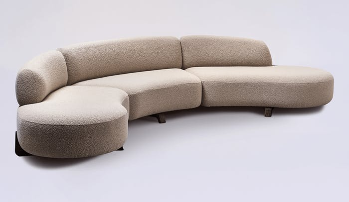"Sofa with a curved profile, beige wool covering and wooden legs.<span class=""sr-only""> (opened in a new window/tab)</span>"