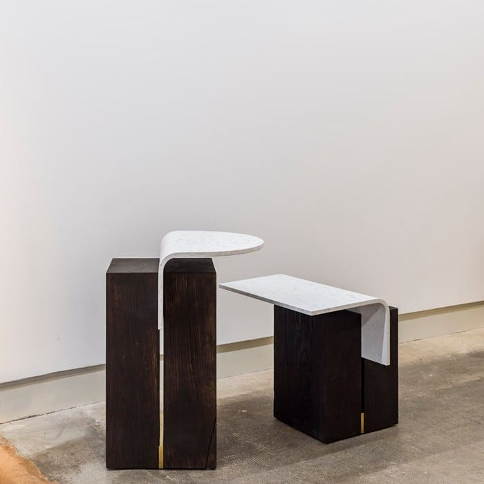 "Minimal sustainable coffee tables with curved white top and dark chunky base.<span class=""sr-only""> (opened in a new window/tab)</span>"