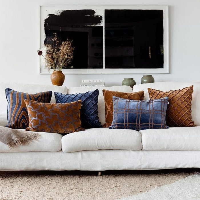 """Front view of a sofa with a rug under it.<span class=""""sr-only""""> (opened in a new window/tab)</span>"""