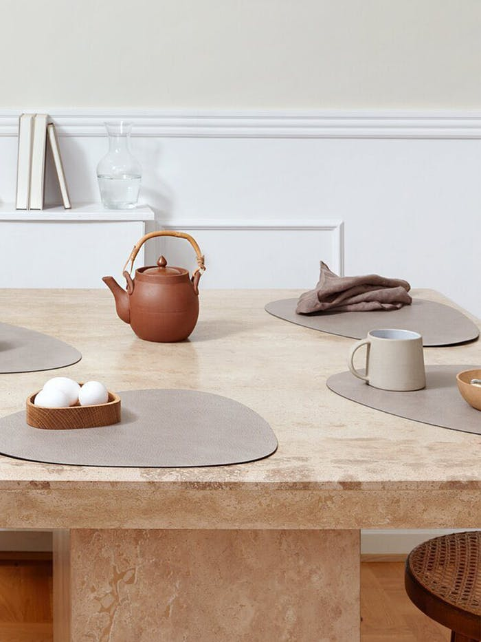 """Stone table set in earthy tones.<span class=""""sr-only""""> (opened in a new window/tab)</span>"""