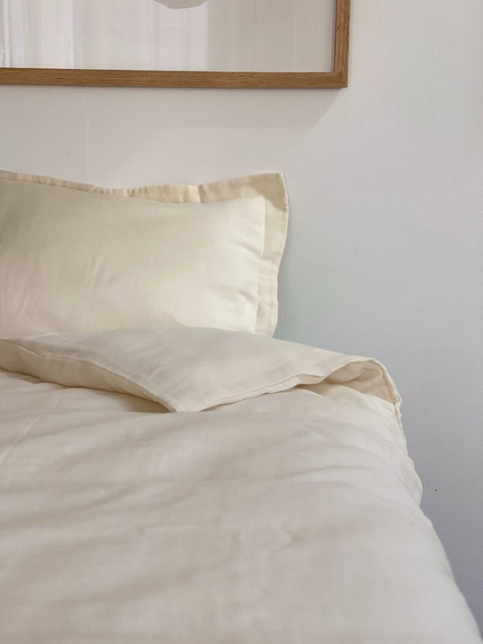 """Front view of a bed with sand bedding.<span class=""""sr-only""""> (opened in a new window/tab)</span>"""