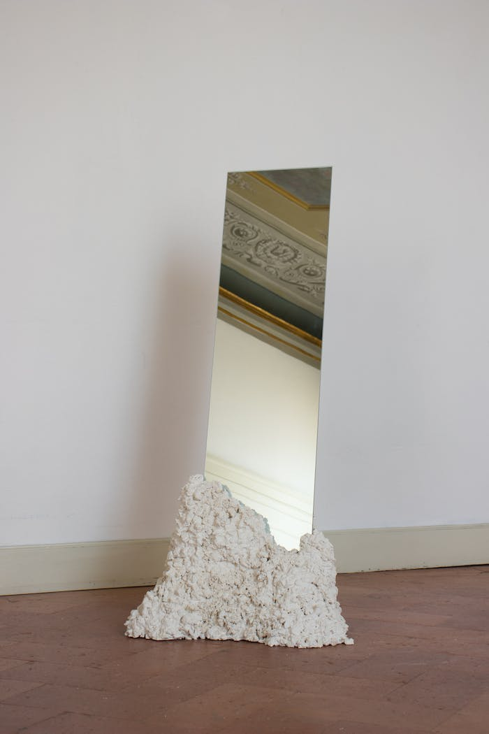 "Rectangular tall mirror kept in place with a recycled stone base.<span class=""sr-only""> (opened in a new window/tab)</span>"