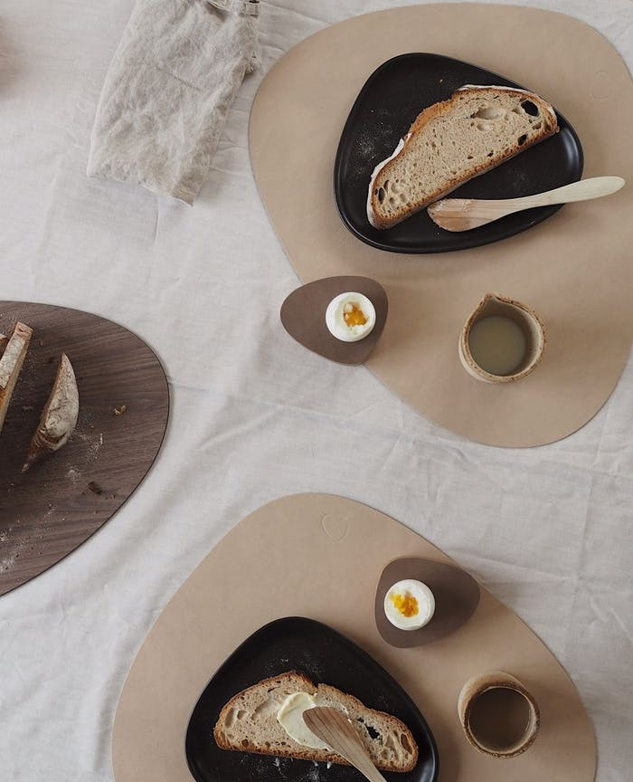 """Sustainable placemats styled on a flatlay.<span class=""""sr-only""""> (opened in a new window/tab)</span>"""