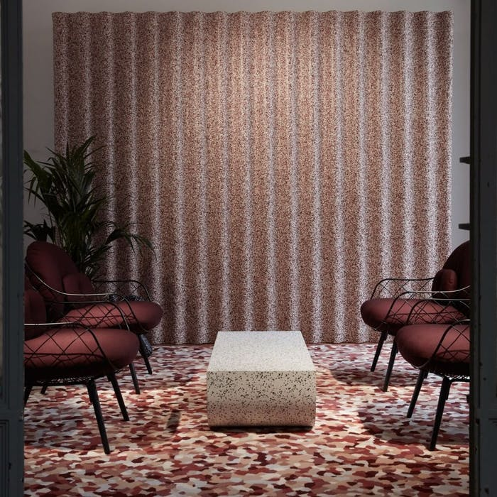 """Seating area with vinyl covering on the wall and flooring.<span class=""""sr-only""""> (opened in a new window/tab)</span>"""