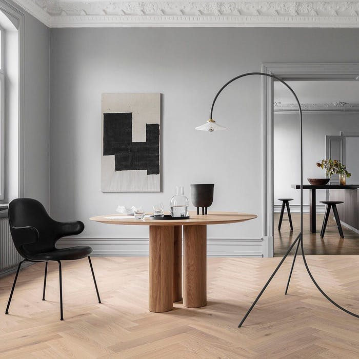 """Room with wood flooring styled with black and neutral furniture.<span class=""""sr-only""""> (opened in a new window/tab)</span>"""