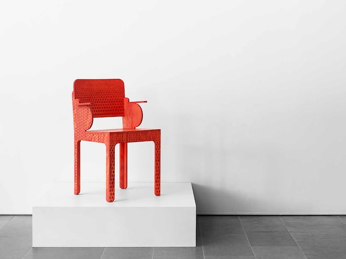 """Wooden chair with red dotted pattern.<span class=""""sr-only""""> (opened in a new window/tab)</span>"""