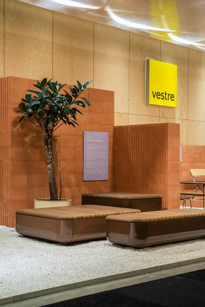 """Overview of Vestre's stand, which uses bricks as partitions and has gravel on the floor.<span class=""""sr-only""""> (opened in a new window/tab)</span>"""