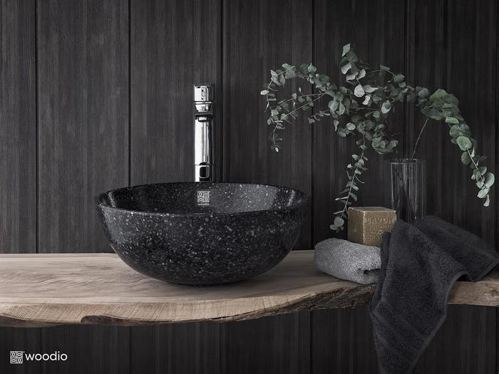 """Black wood-chips faucet mounted on a wood top.<span class=""""sr-only""""> (opened in a new window/tab)</span>"""