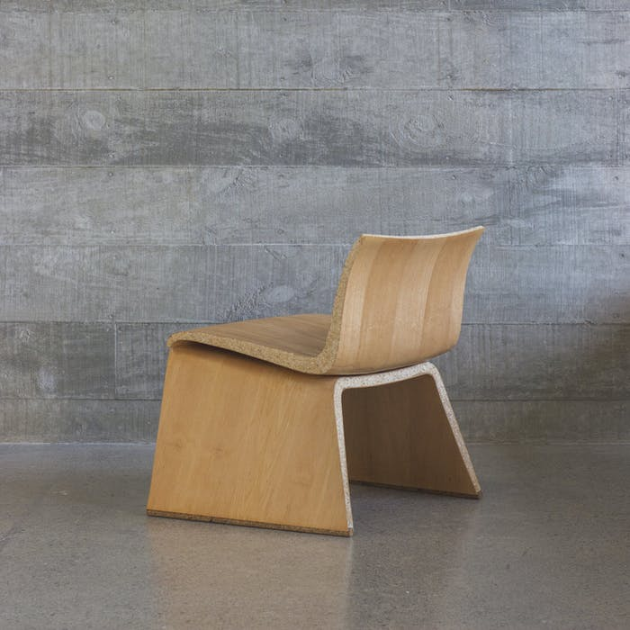 "Organic shape chair that looks like a regular bent-wood chair but it's actually an example of biofabriction.<span class=""sr-only""> (opened in a new window/tab)</span>"
