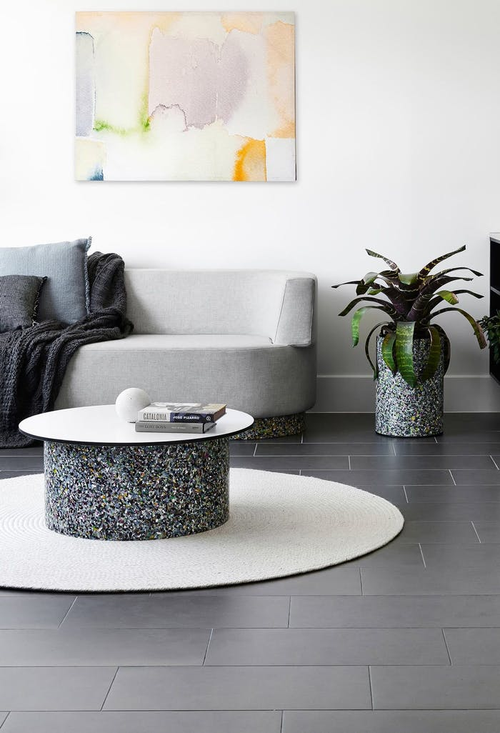 """Contemporary living room with sofa and coffee table with legs made of recycled plastic terrazzo.<span class=""""sr-only""""> (opened in a new window/tab)</span>"""