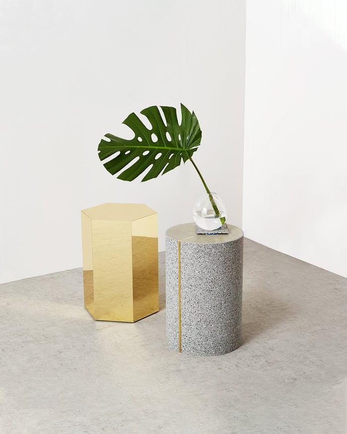 """Minimal shot displaying a light grey side table made of recycled rubber.<span class=""""sr-only""""> (opened in a new window/tab)</span>"""
