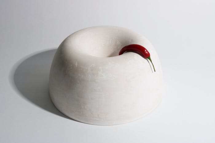 "White bowl with a red pepper hanging onto it.<span class=""sr-only""> (opened in a new window/tab)</span>"