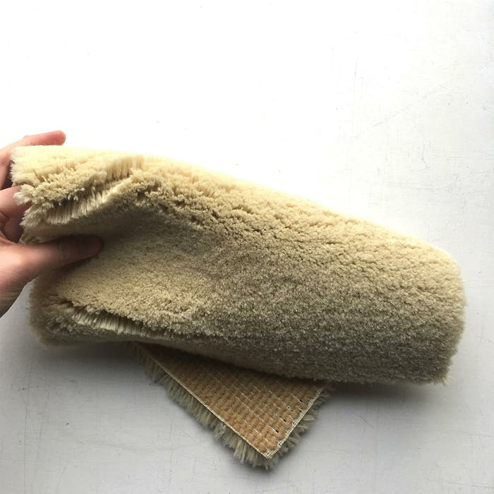 """A piece of Robotuft rug folded.<span class=""""sr-only""""> (opened in a new window/tab)</span>"""