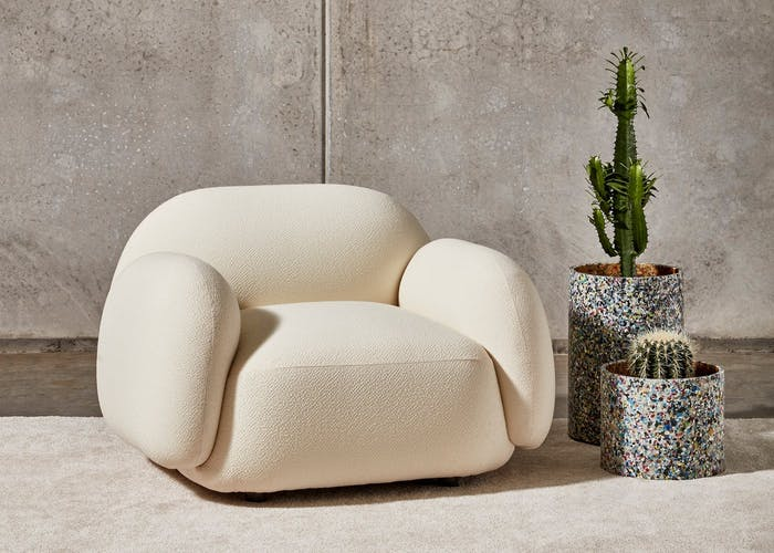 """Recycled plastic planters next to a soft armchair.<span class=""""sr-only""""> (opened in a new window/tab)</span>"""