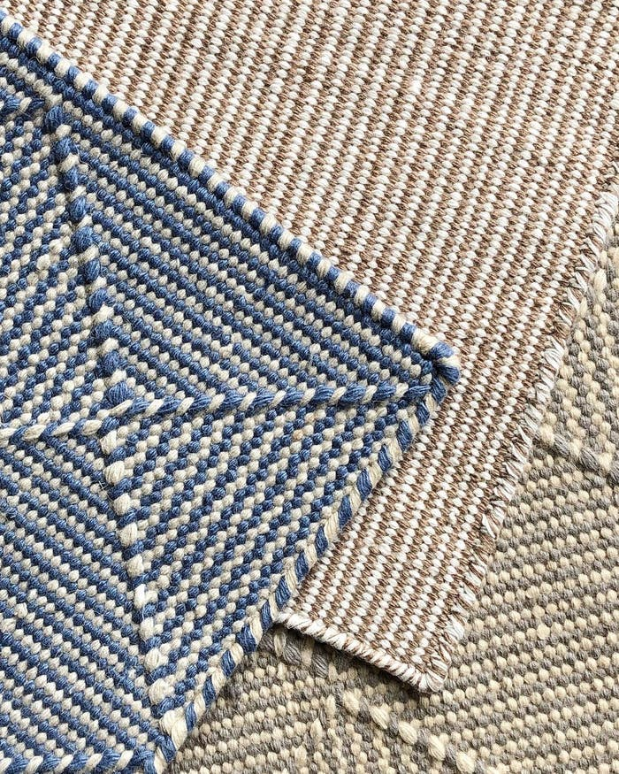 """Close-up of recycled plastic rug textures.<span class=""""sr-only""""> (opened in a new window/tab)</span>"""