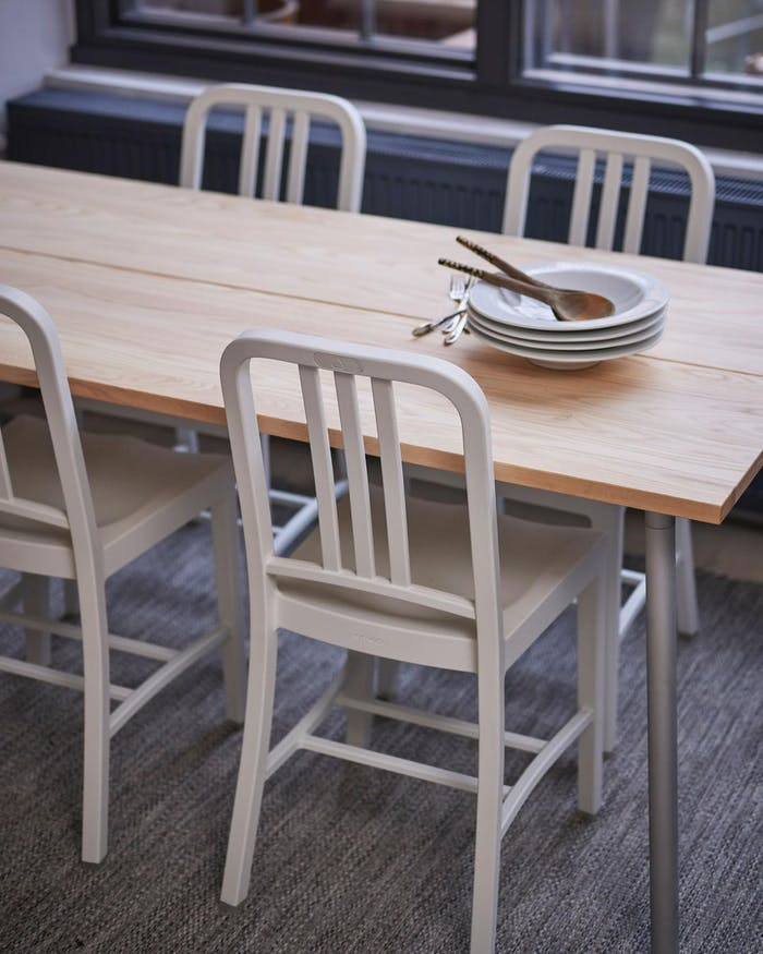"""Recycled aluminium chairs around a table.<span class=""""sr-only""""> (opened in a new window/tab)</span>"""
