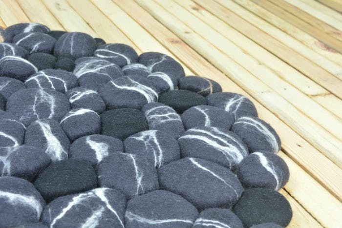 """Close-up of a felt stone rug.<span class=""""sr-only""""> (opened in a new window/tab)</span>"""
