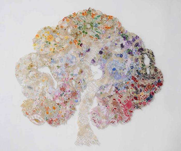 """Textile art tree made up of reused pieces of needlework, pins and tulle.<span class=""""sr-only""""> (opened in a new window/tab)</span>"""